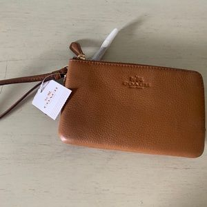 Coach brown leather wristlet.  NWT